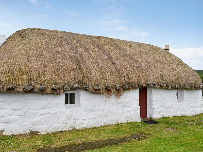 Beaton's Croft Kilmuir near Uig Skye exterior of thatched cottage