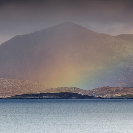 Christopher Swan: Harris in the Spring - rainbow over the sea & mountain bacdrop
