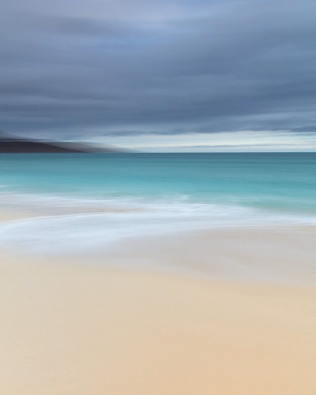 In Balance - Impressionist image of Tràigh Scarista on the Isle of Harris. Taken not long after sunrise in February 2017, the lilac tones in the sky are gorgeous against the aqua and white sea and the light sand. Scarista Beach is possibly my favourite spot on Harris. It speaks to me and this image recreates the feeling of an almost dreamlike calm, balance and contentment that I get when I spend time there.