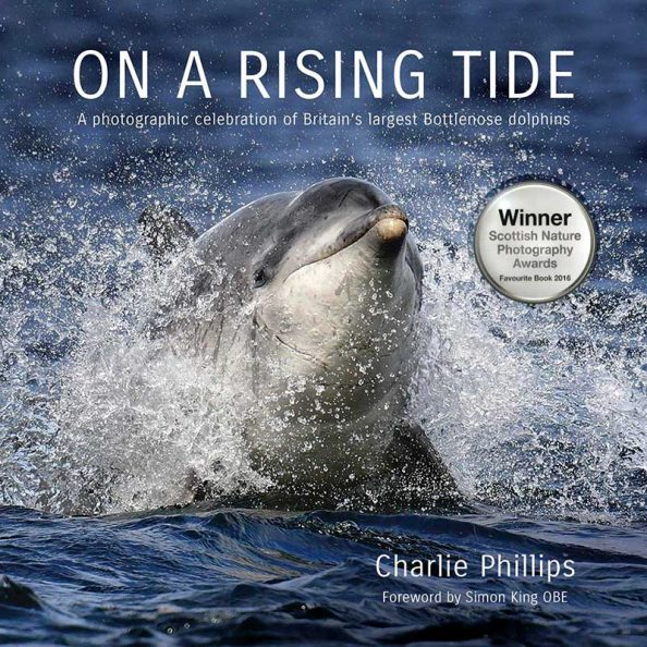 On a Rising Tide book about bottlenose dolphins - Charlie Phillips