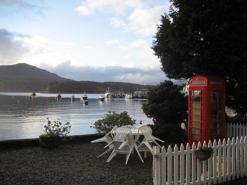 Portree Bay House Skye - Beach-front garden with telephone box - unique places to stay in Scotland
