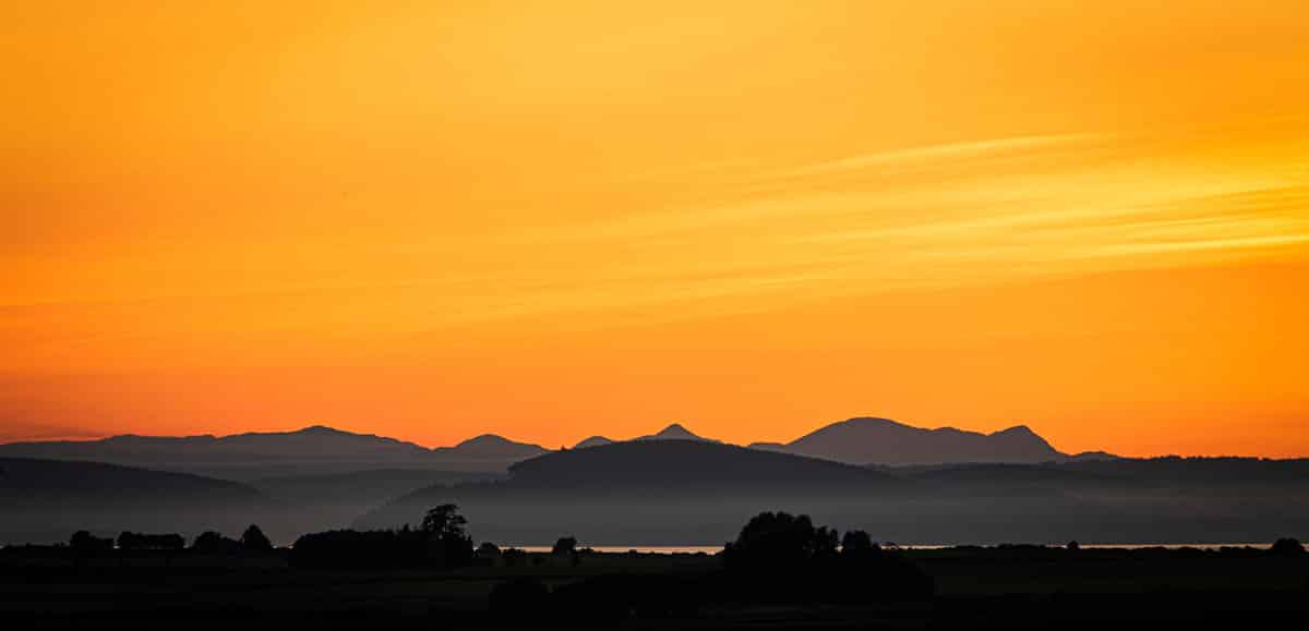 Sunset over the Moray Firth to the Black Isle and then the peaks of Ben Wyvis beyond - things to do near Nairn