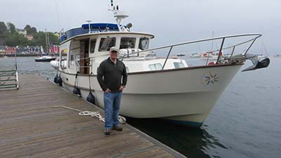 Nigel Waterson with his boat, Spindrift IV